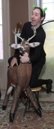 This is what happens when a little man tries to climb on a deer prop.
