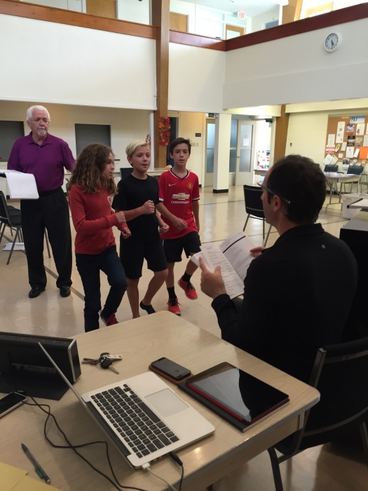 Co-Director Joel Varty works with the children's ensemble and Gary Potter (Toymaker)